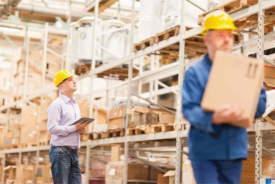 warehouse manager checking inventory